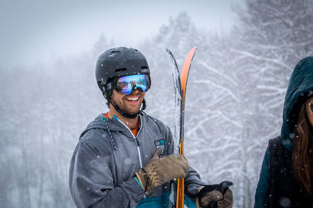 A person holding a snow board